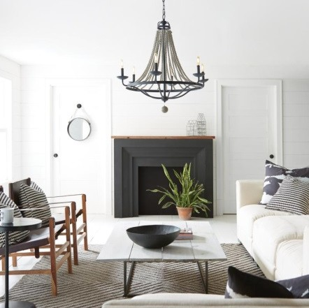 living room in pale muted colors with elegant chandelier