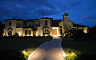 beautiful home with well lights around the perimeter